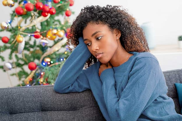 a woman considers the seasonal depression signs