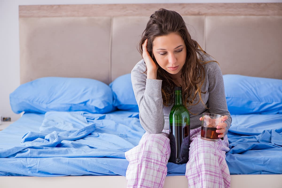 woman with glass of wine wonders am I an alcoholic
