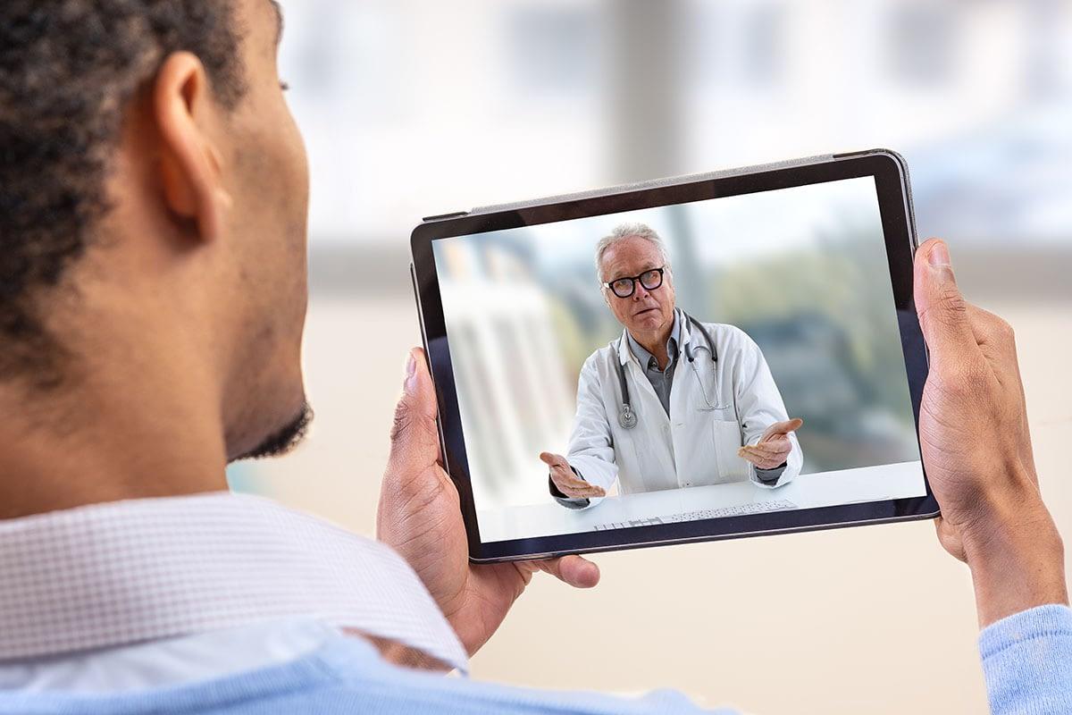 doctor on screen for telehealth