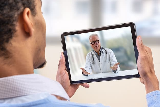 doctor on screen for telehealth