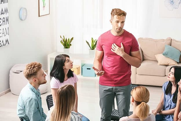 people engage in a group therapy program
