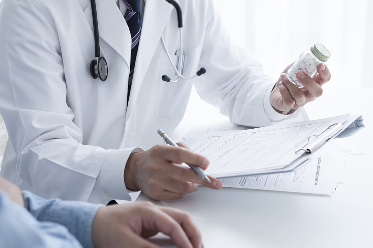 a patient asks a doctor with a clipboard what is medical detox