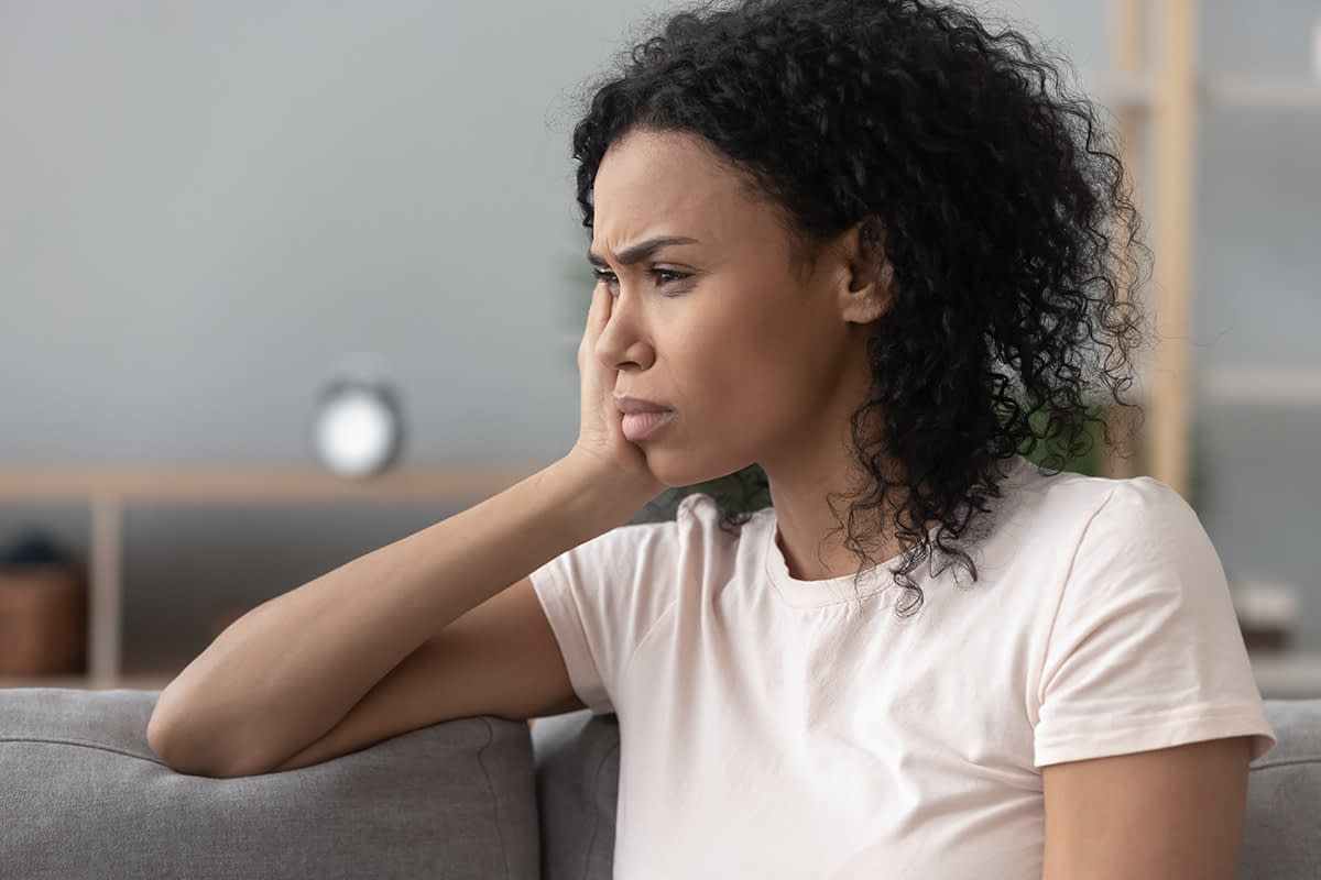a woman feeling stress about a loved one asking why do people binge drink