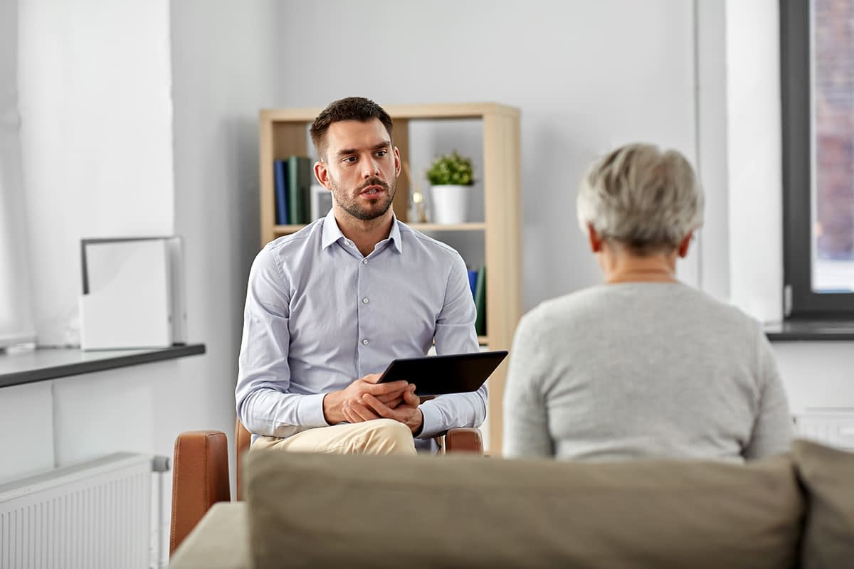 an older woman talking to her doctor about disruptive mood dysregulation disorder