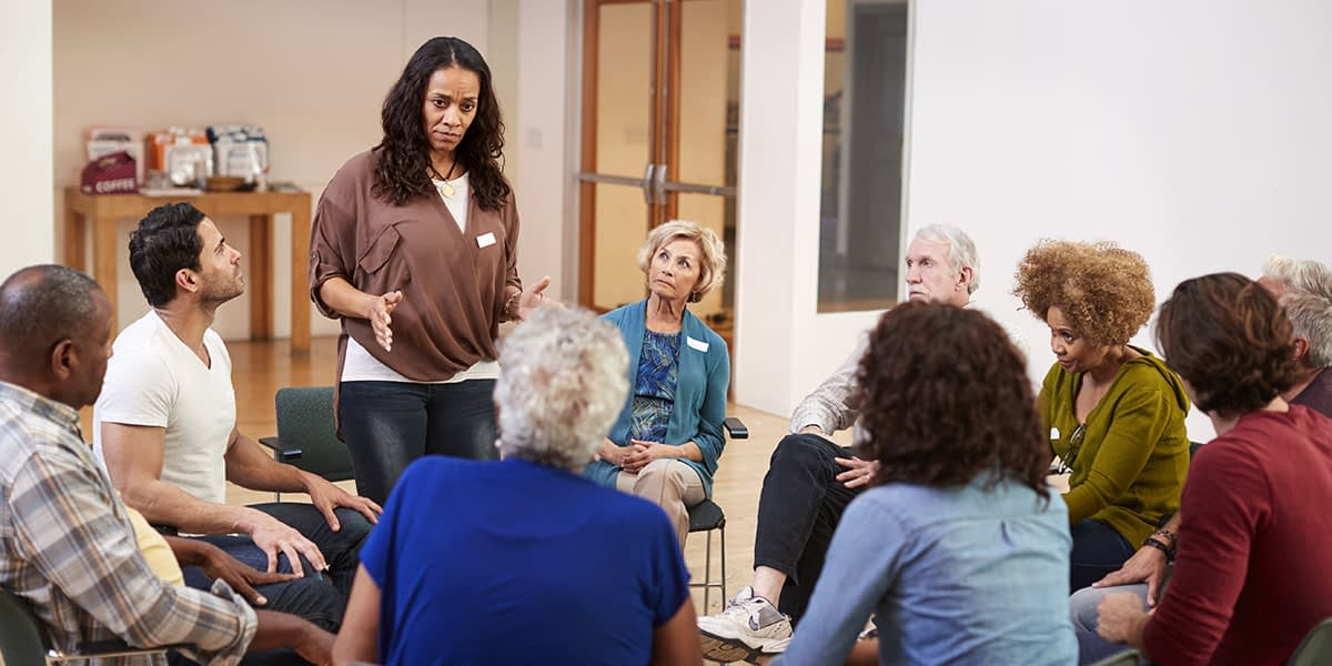Woman speaking at anger management rehab