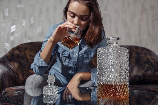 a woman who needs alcohol addiction rehab center