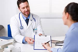 Doctor explaining Cigna rehab insurance coverage to his patient