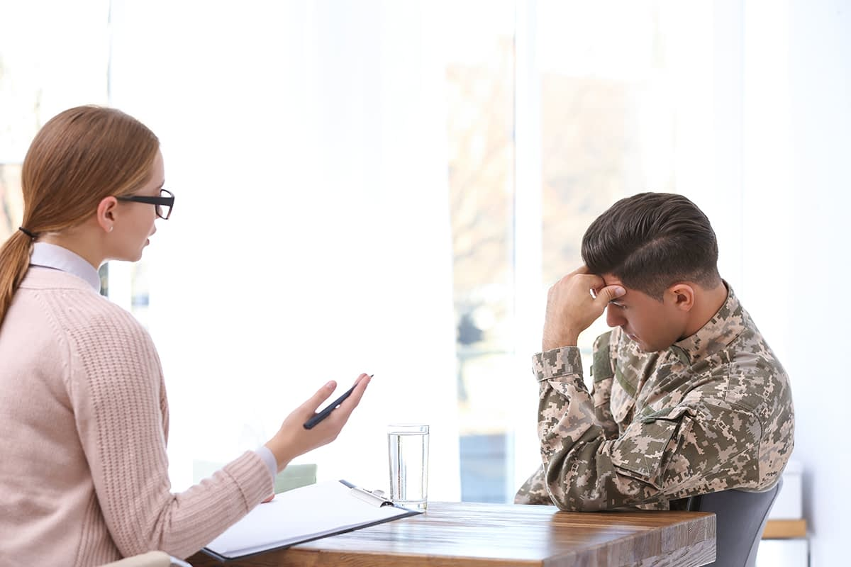 a man distraught learning about what is PTSD