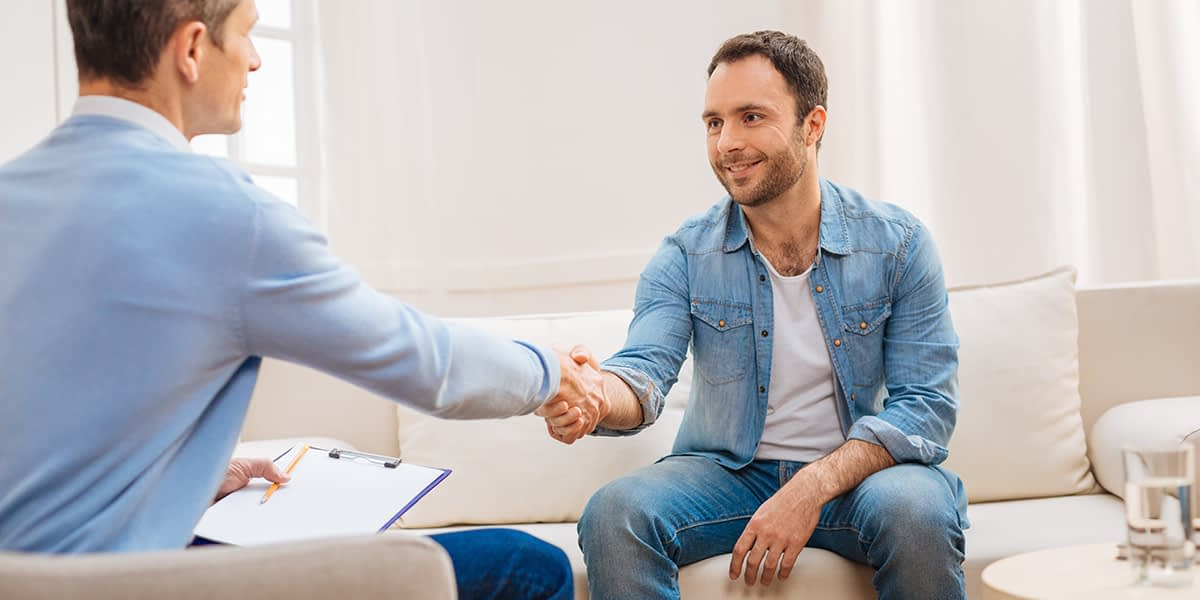 Man and therapist developing a wellness recovery action plan