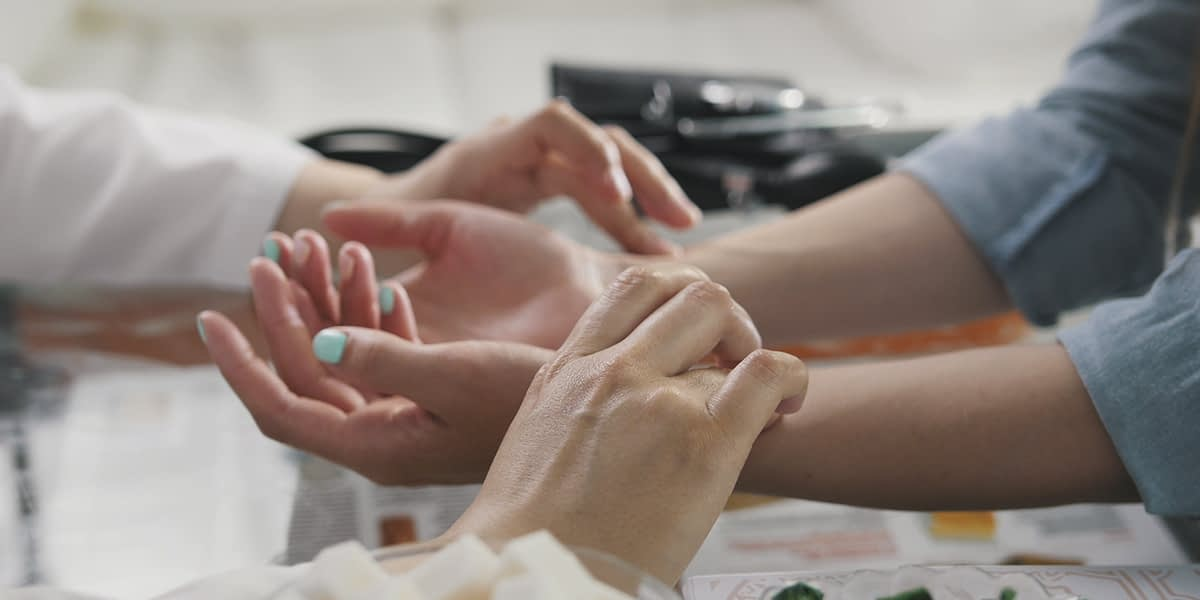 a doctor explaining Five Holistic Therapy Options