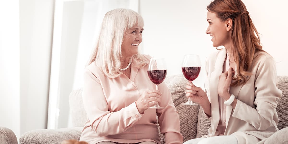 two women drinking ignoring Wine Mom Culture