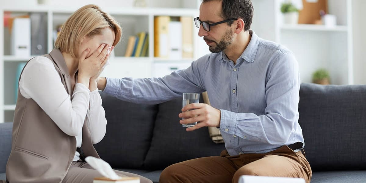 Upset woman learning what is acceptance and commitment therapy