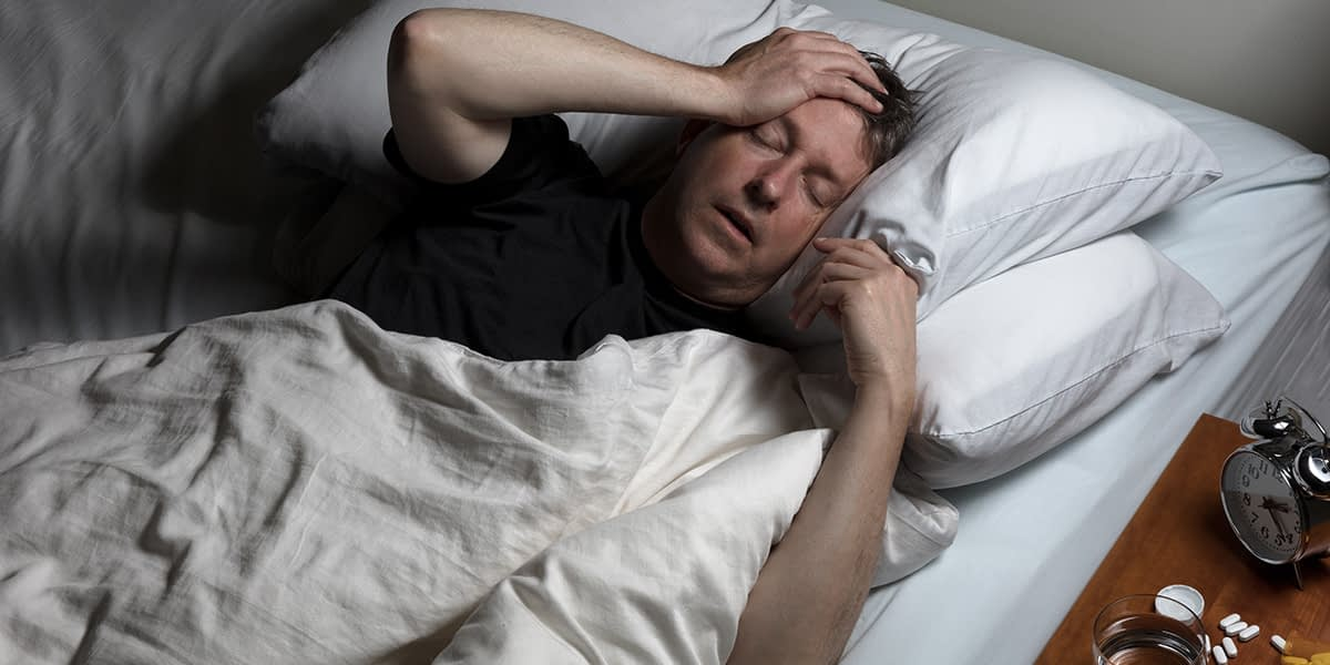 man lying down in bed suffering from addiction taking Lucemyra To Treat Opioid Withdrawal