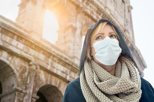 woman with a mask in public showing epidemic vs pandemic