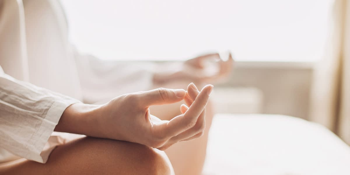 a woman meditating after asking can mindfulness meditation work for addiction