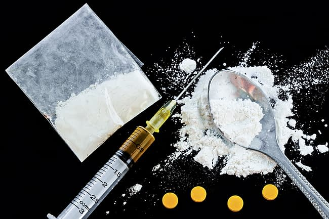 a pile of drugs belonging to someone who needs a amphetamine addiction rehab center