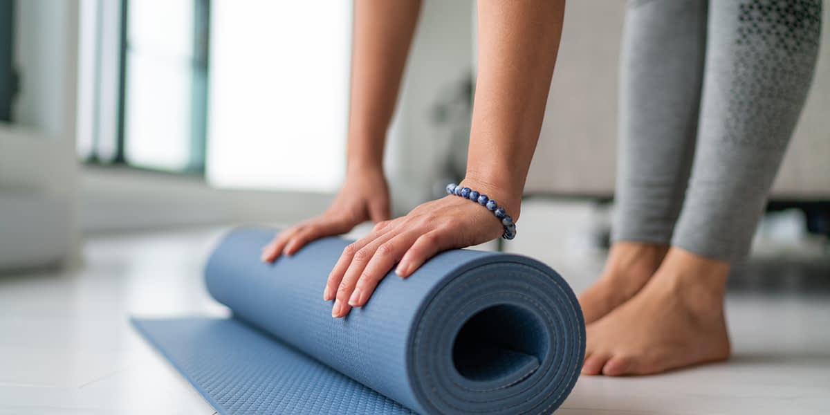 a person doing yoga as a stress management technique