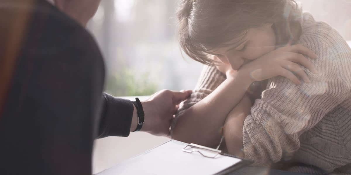 Woman receiving counseling for both trauma and addiction