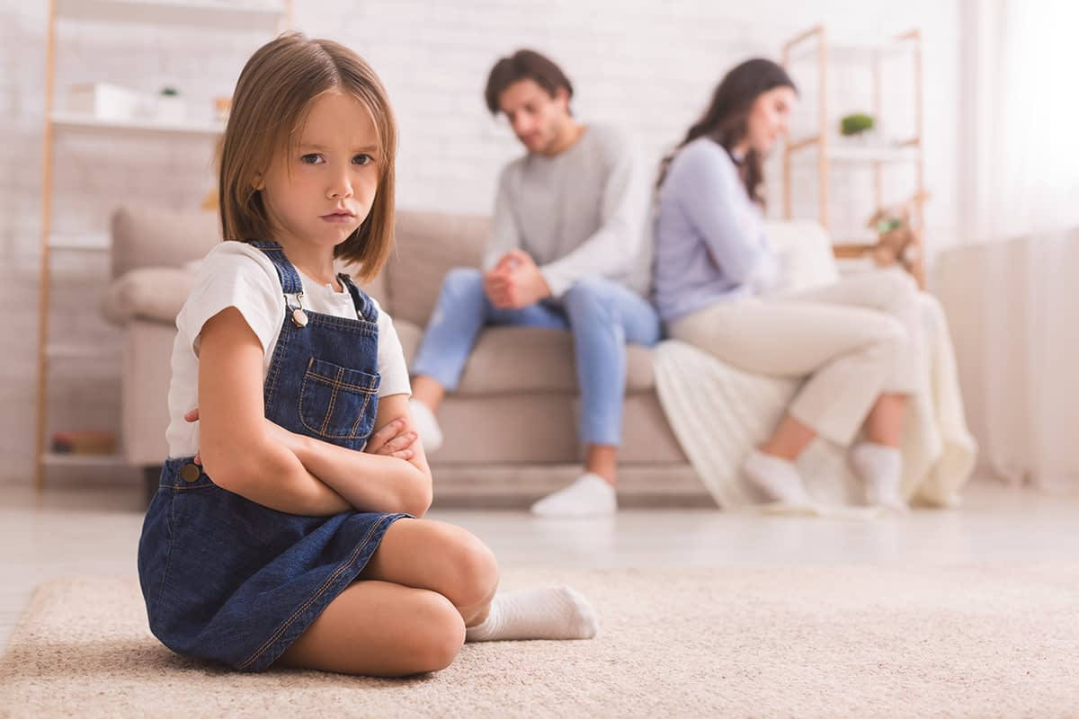 a young girl listening to her parents argue not knowing about childhood trauma and addiction