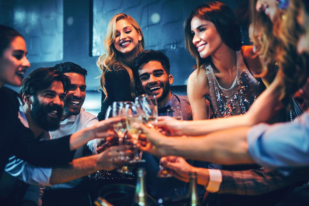 a group of friends enjoying alcohol and young adults