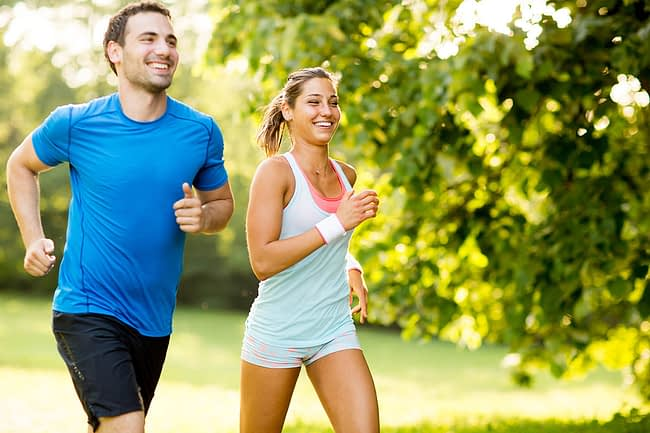 Man and woman use jogging as a method for how to stay sober