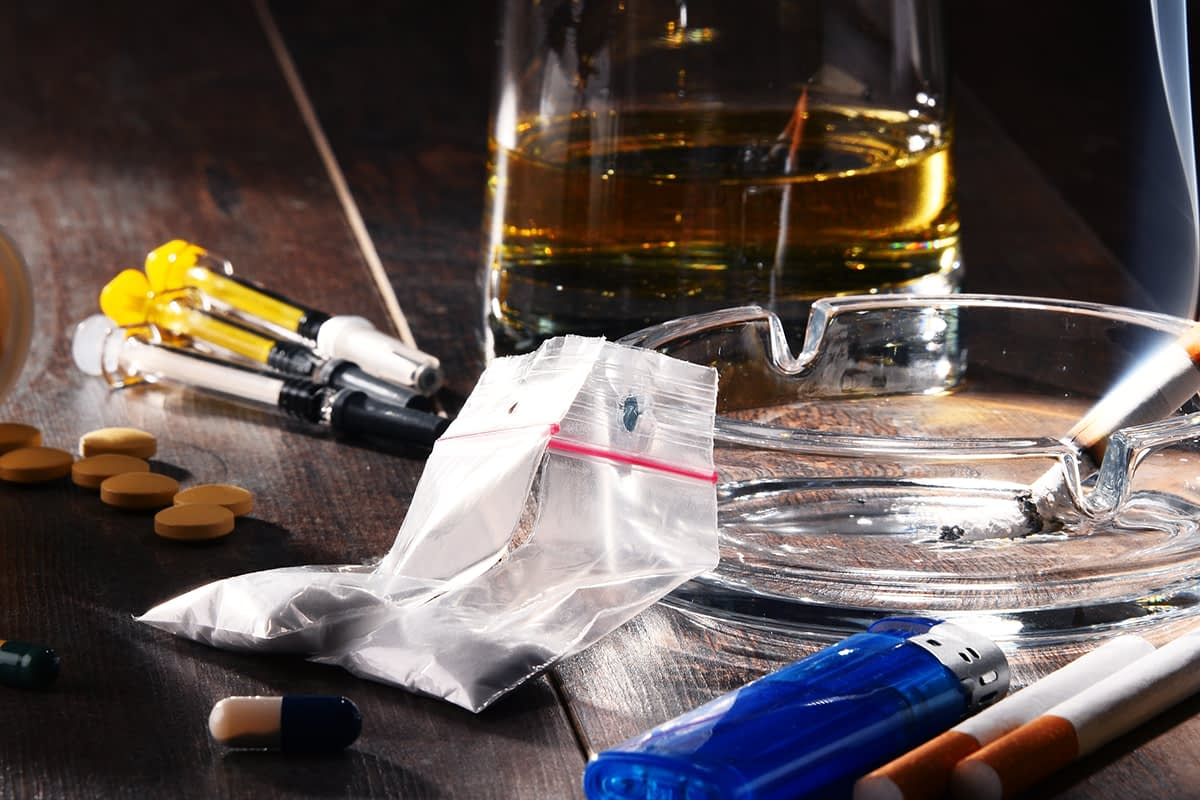 a pile of drug showing dangers of mixing substances