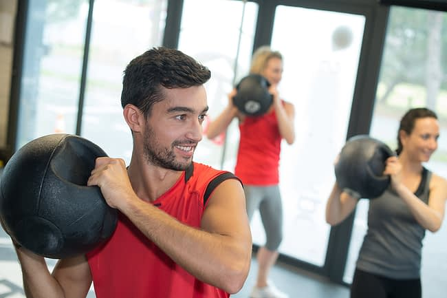 a group exercise in gym therapy