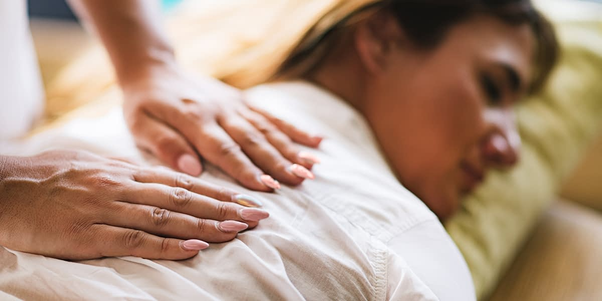 a woman getting a massage during holistic drug rehab