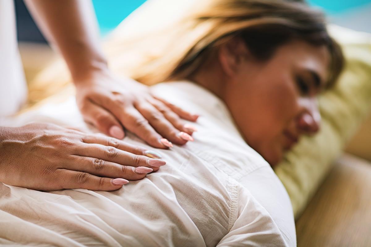 a woman getting a massage during holistic drug rehab