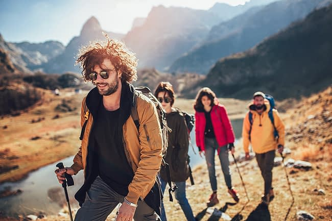 a group of people hiking during a wilderness therapy program