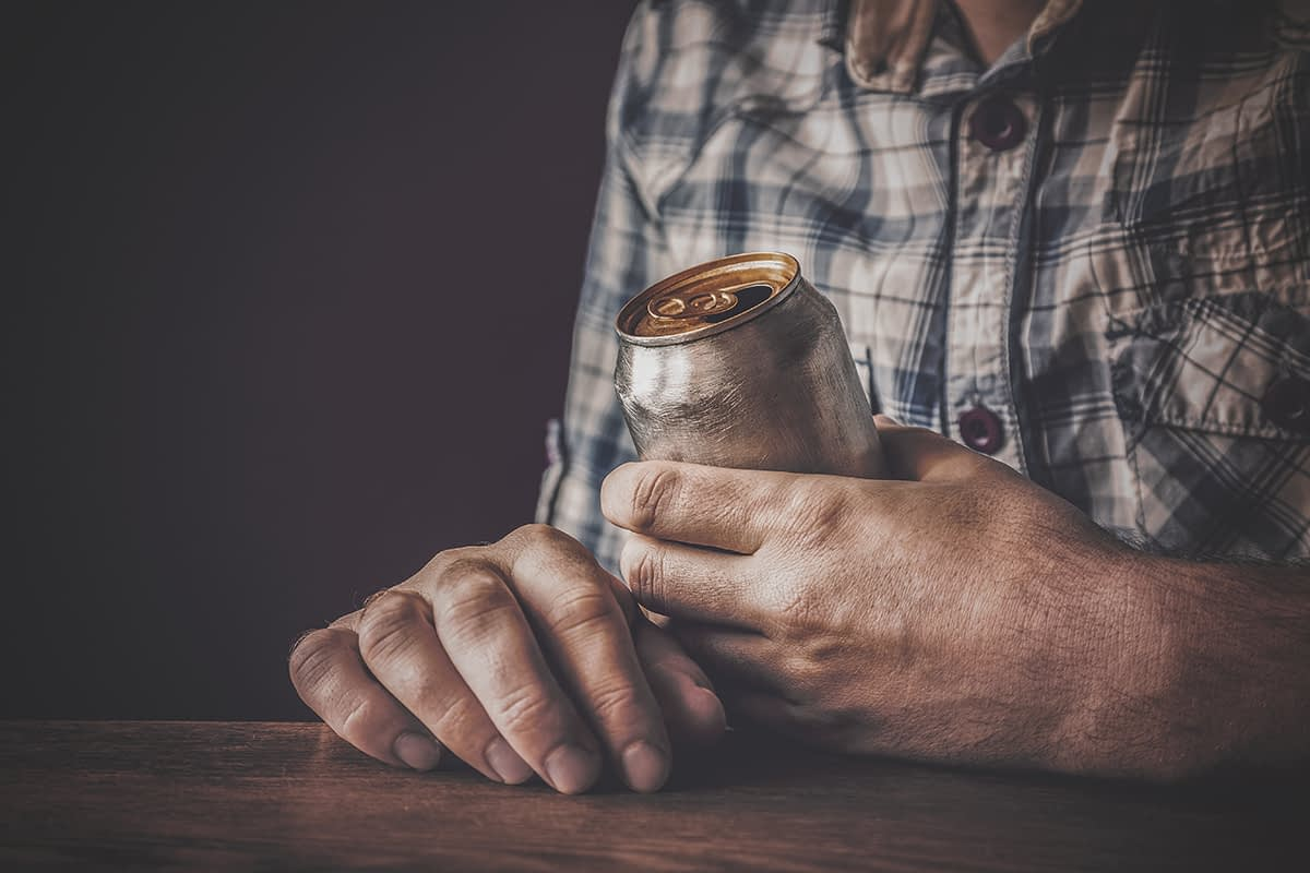 a man drinking a lot wondering what is too much drinking