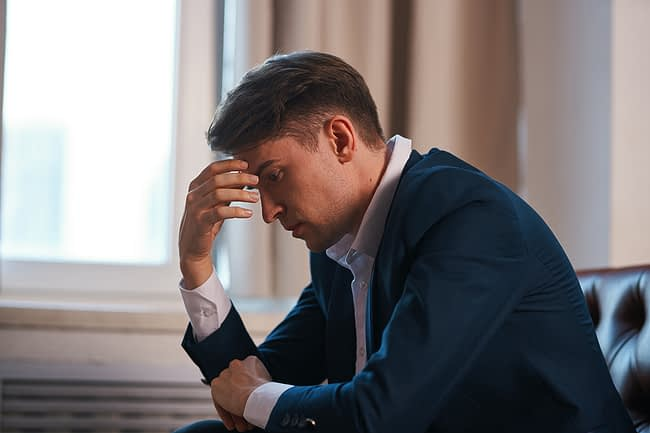 a man feeling stress at a codependency therapy