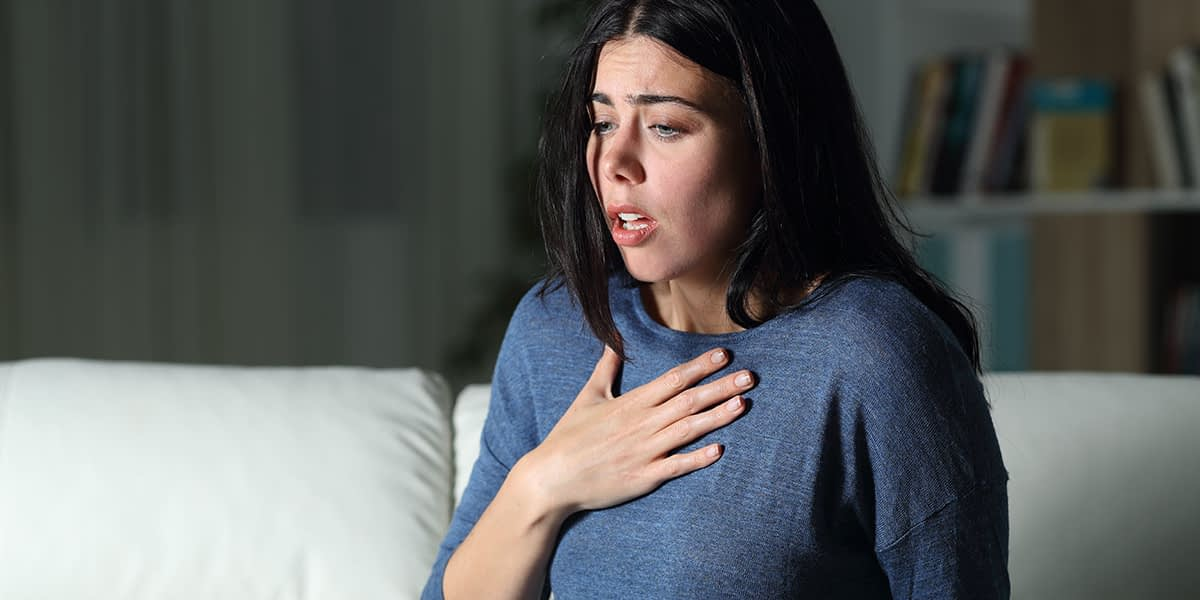 a woman suffering from triggers of anxiety attacks