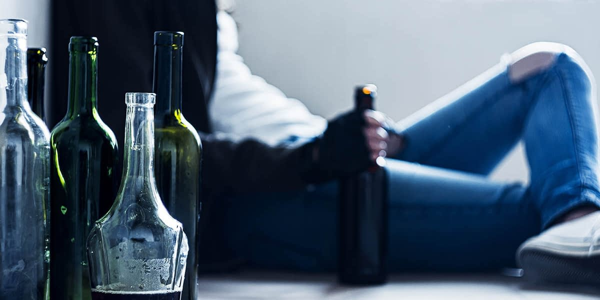a man struggling with alcohol dependence