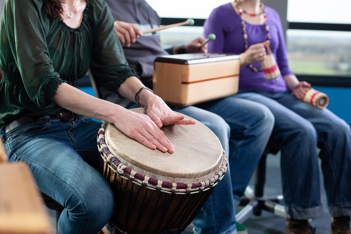 people playing instruments in a recreational therapy