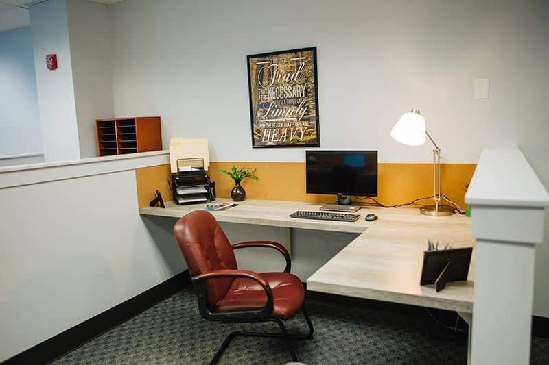 L-shaped desk in an open office setting at Bayview Recovery Center
