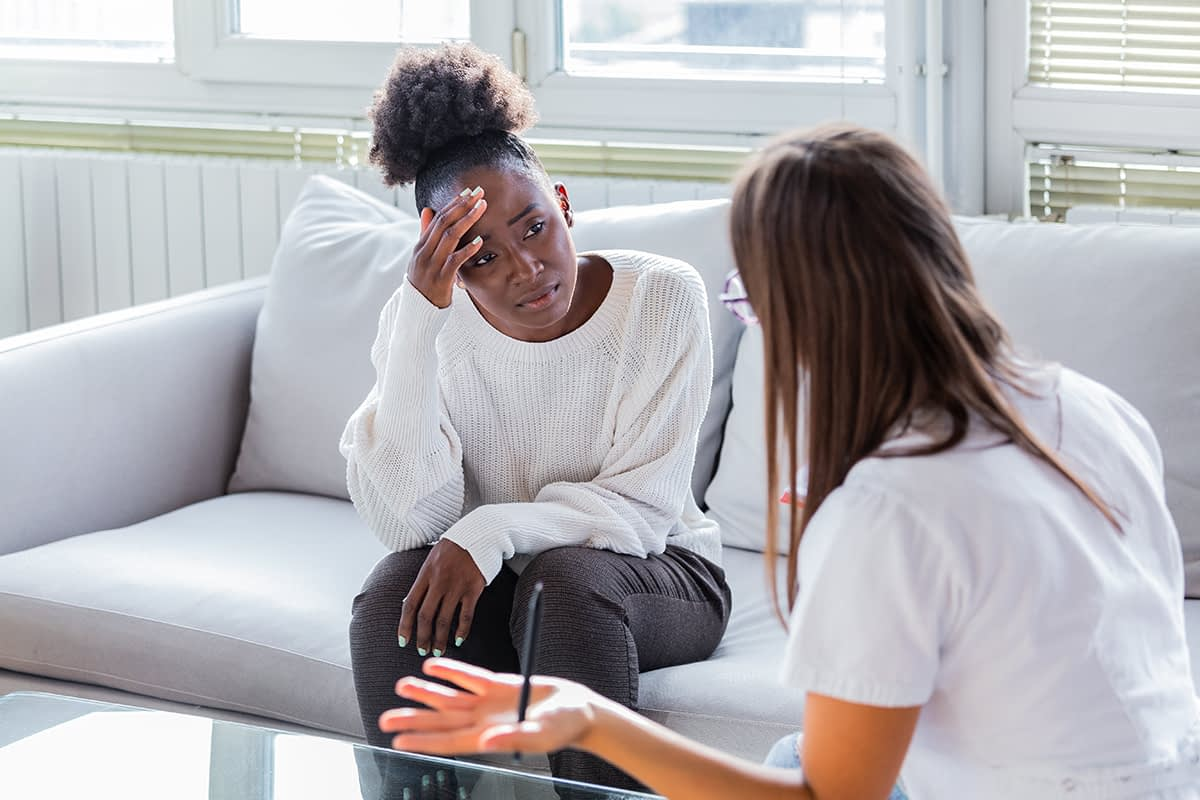 a young woman talking to her doctor about acceptance and commitment therapy