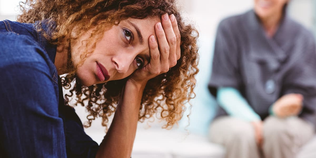 Woman struggling with the symptoms of hallucinogen persisting perception disorder