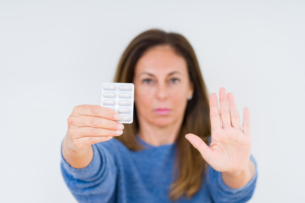 a woman stopping taking drugs after learning how to stop drug abuse