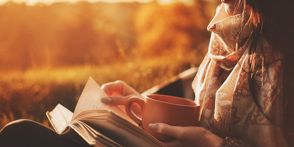 a woman reading as a way of coping with loneliness