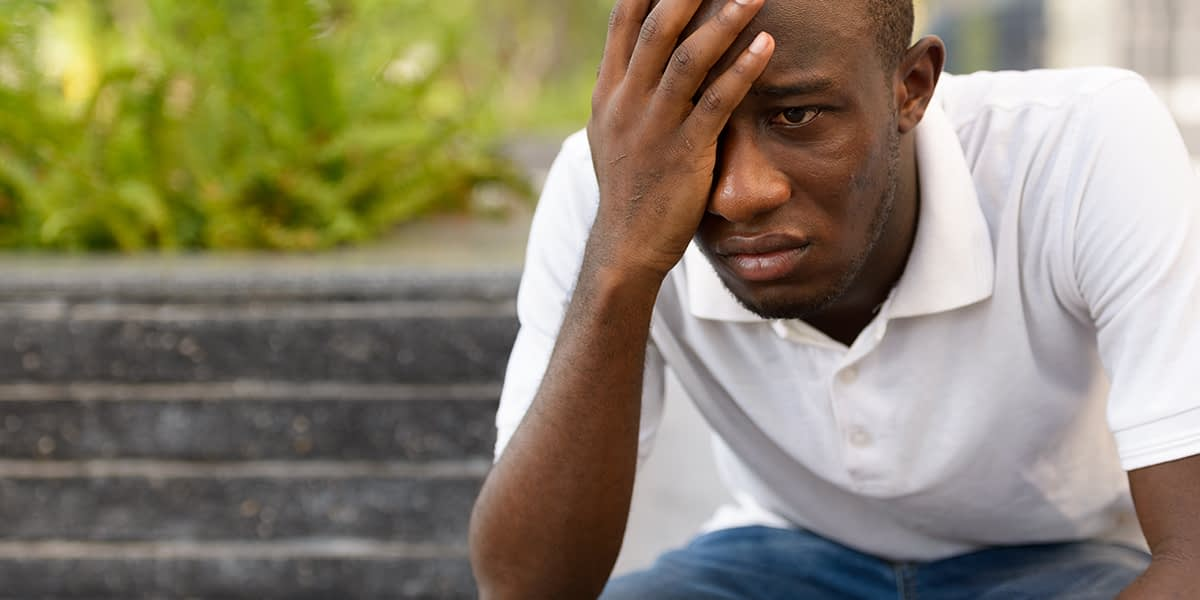 a man struggling while Identifying Addiction Relapse Triggers