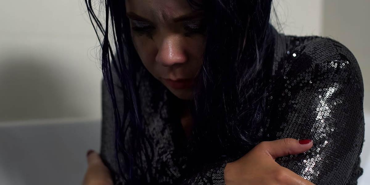 a woman feeling sick as she goes through heroin overdose