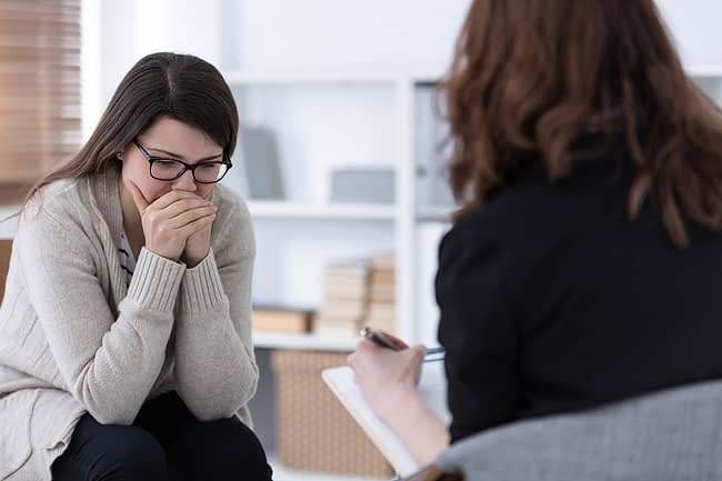 a woman talking to her doctor about acute stress disorder