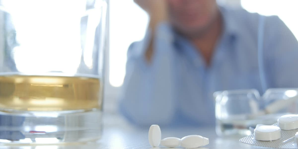 a man mixing benzos and alcohol