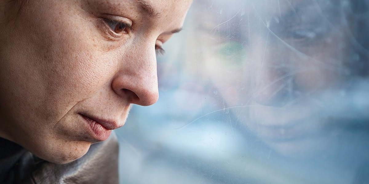 a woman thinking about process addiction