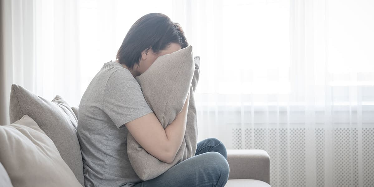 a woman struggling to deal with the signs of anxiety