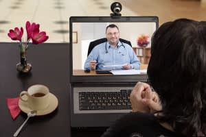 a woman talking to a doctor displaying a telehealth intensive outpatient program