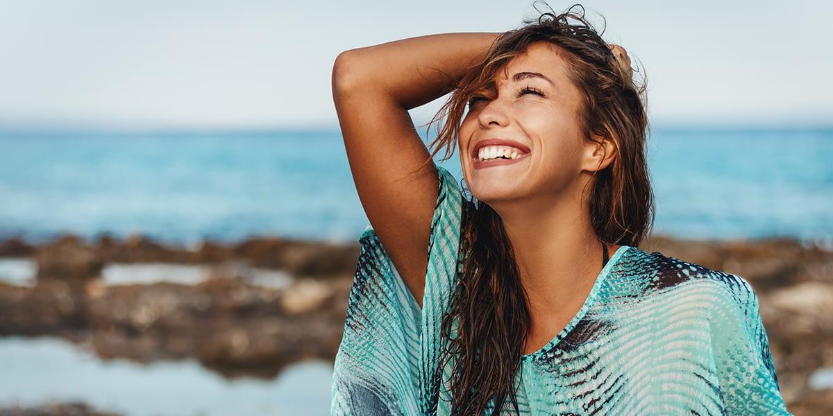 a woman enjoying a sober summer at the beach