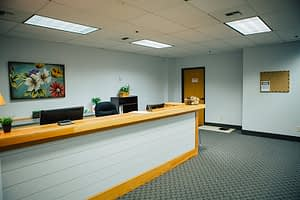 Long white reception desk at the Bayview Recovery Center
