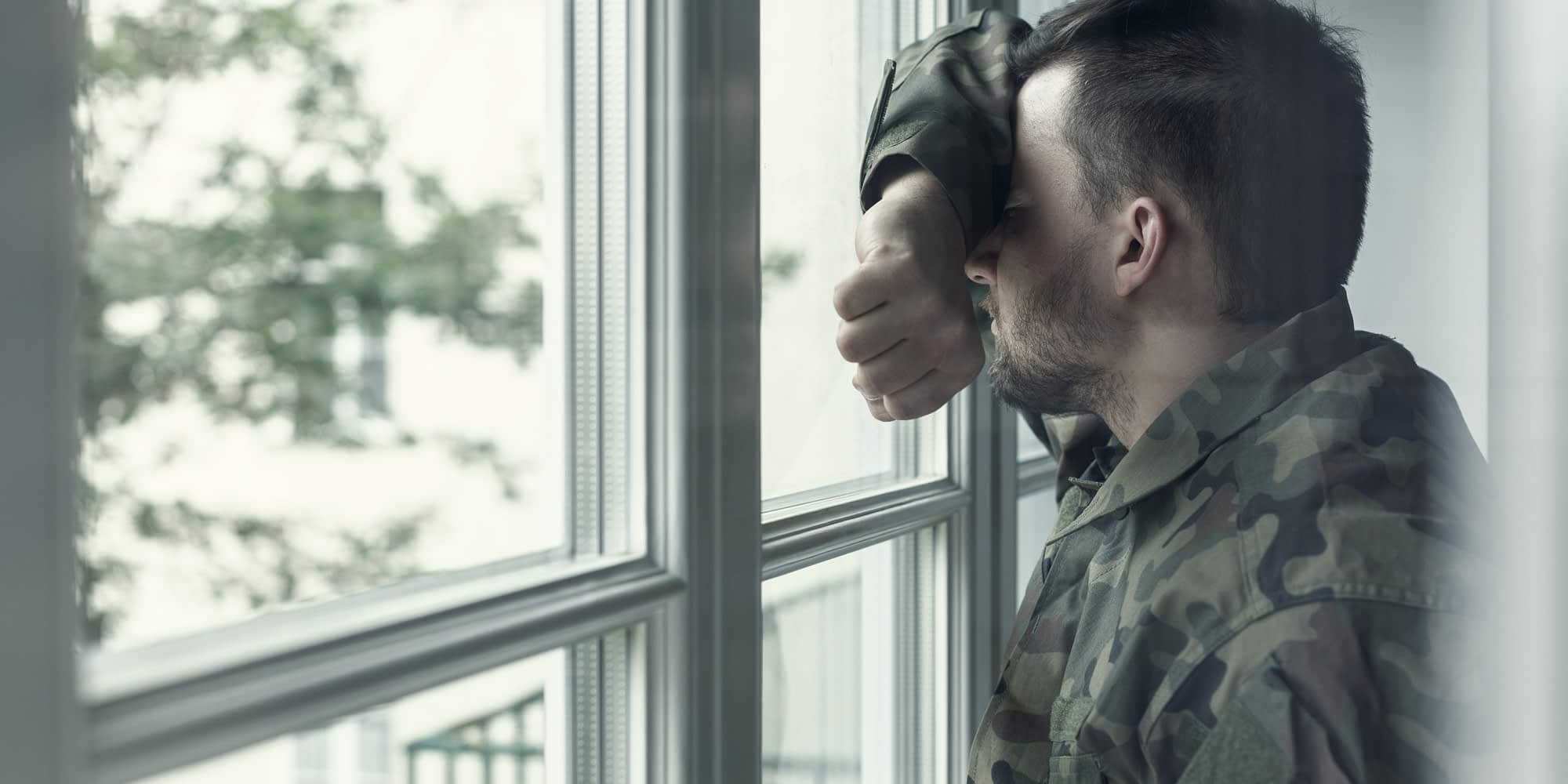 a person dealing with ptsd and drug addiction